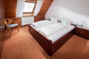 Ferienhaus Harmening FeWo 4 - Schlafzimmer