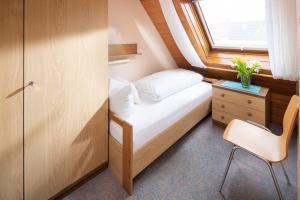 Ferienhaus Harmening FeWo 5 - Kleines Schlafzimmer